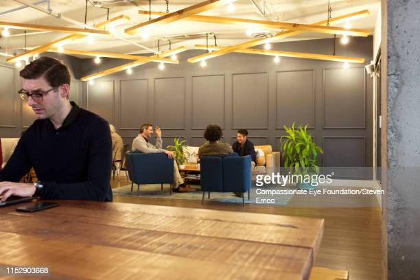 """creative business people having meeting in modern open plan office - """"compassionate eye"""" stock pictures, royalty-free photos & images"""