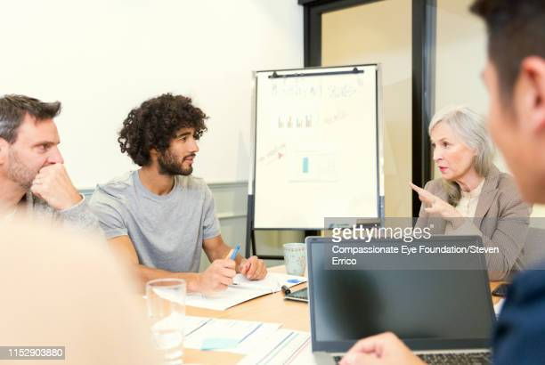 """creative business people having meeting in office - """"compassionate eye"""" stock pictures, royalty-free photos & images"""