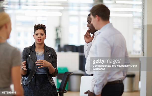 creative business people having meeting in office - vanguardians stock pictures, royalty-free photos & images