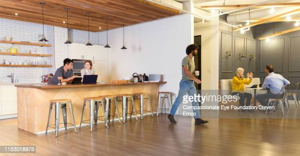 """creative business people having meetings in co-working space - """"compassionate eye"""" stock pictures, royalty-free photos & images"""