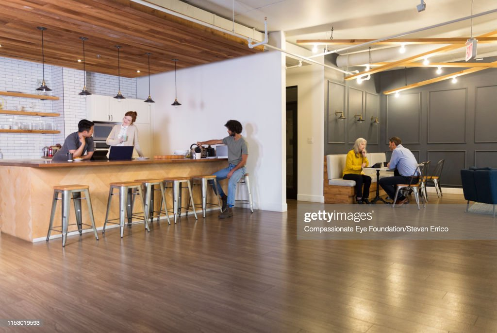 Creative business people having meetings in co-working space : Stock Photo