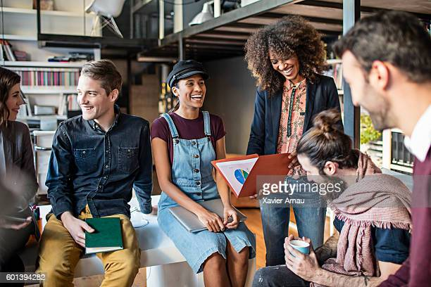 Creative business people laughing in meeting