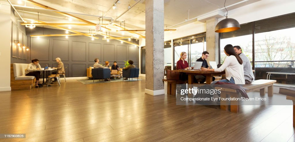Creative business people working in modern creative office : Stock Photo