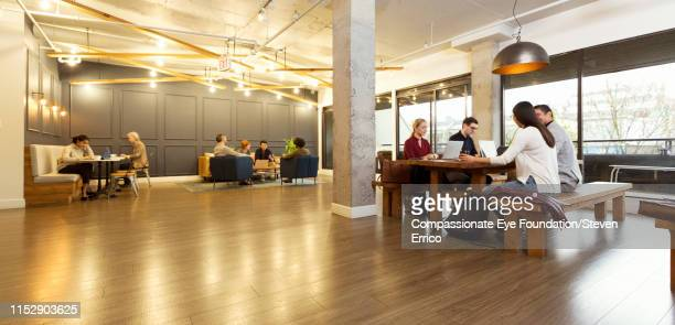 "creative business people working in modern creative office - ""compassionate eye"" stock pictures, royalty-free photos & images"