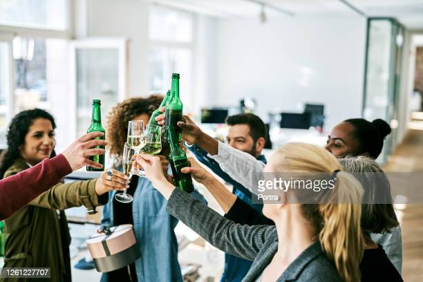 creative business professionals toasting drinks - celebration stock pictures, royalty-free photos & images