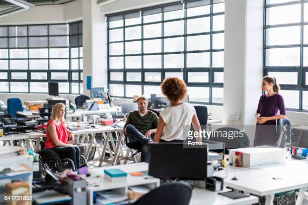 Creative business team discussing in modern office