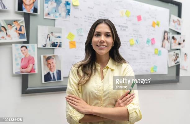 Creative business woman at the office in front of a whiteboard