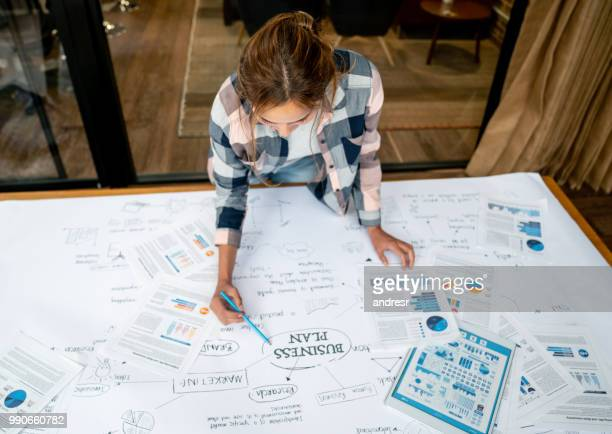 creative business woman drawing a business plan - business plan stock pictures, royalty-free photos & images