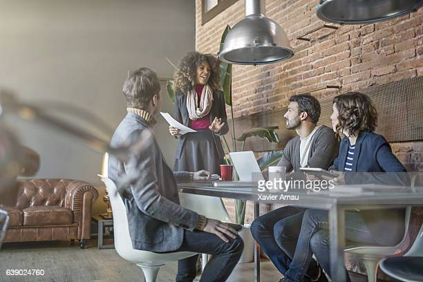 Creative business woman leading a meeting