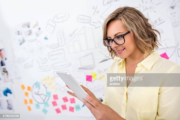 Creative business woman working on a tablet computer