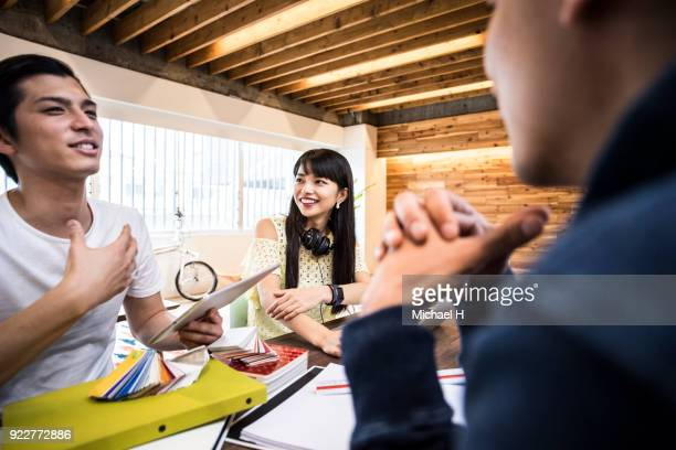 Creative businessman explaining to coworker close-up