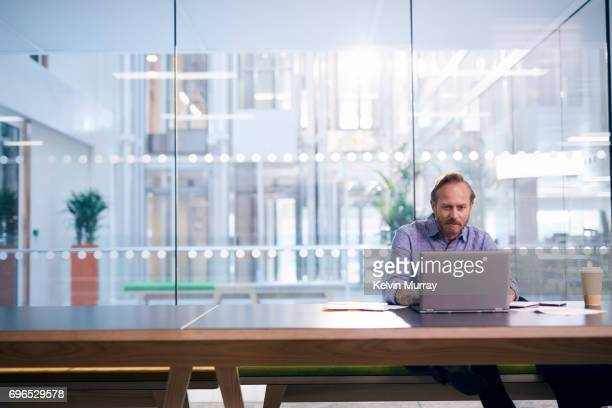 creative businessman using laptop in conference room - human body part stock pictures, royalty-free photos & images