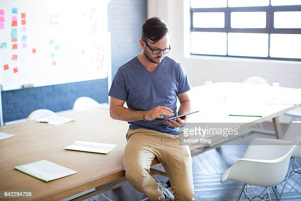 Creative businessman working on a tablet computer