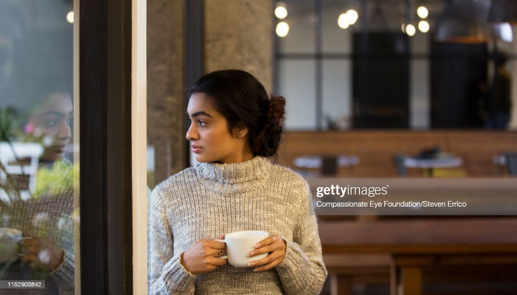 Creative businesswoman looking out office window : Stock Photo