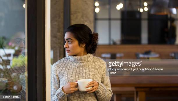 """creative businesswoman looking out office window - """"compassionate eye"""" stock pictures, royalty-free photos & images"""