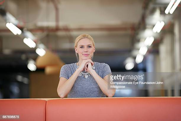 Creative businesswoman smiling in office