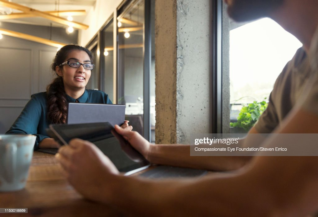 Creative businesswoman using digital tablet in modern open plan office : Stock Photo