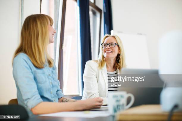 Creative businesswomen discussing in office