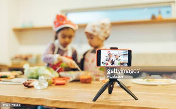 creative children making a cooking show with smartphone - live broadcast stock pictures, royalty-free photos & images