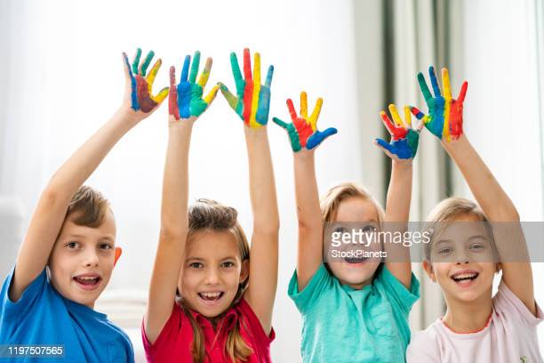 creative children - 4 girls finger painting stock pictures, royalty-free photos & images