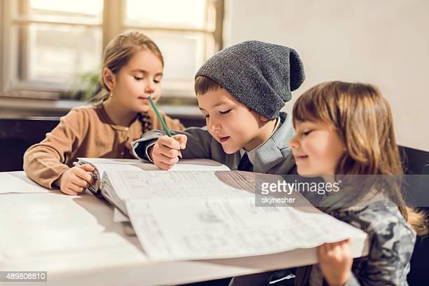 Creative children working on construction plans.