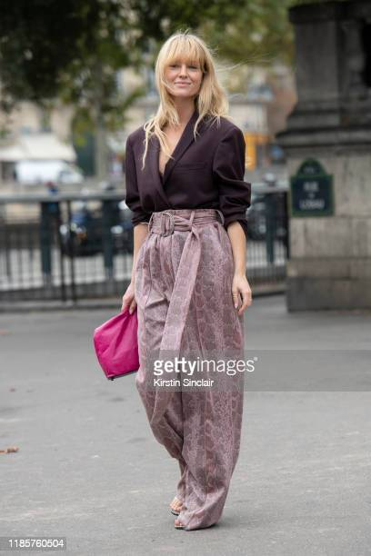 Creative consultant and stylist Jeanette Friis Madsen wears a Simon Miller bag, Samsoe Samsoe jacket, Staud trousers on September 26, 2019 in Paris,...