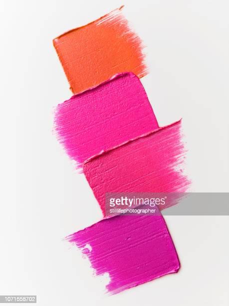creative cosmetic smears on white background - pintalabios fotografías e imágenes de stock