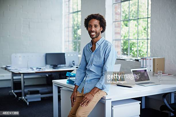 creative designer in modern office - beige pants stock photos and pictures