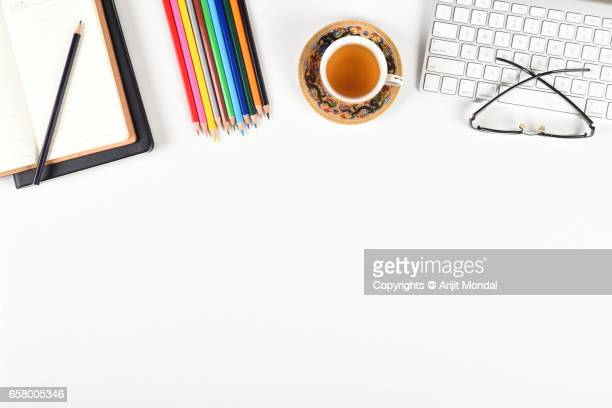 creative designers office table top view with colour pencils, computer keyboard, green tea - website template stock photos and pictures