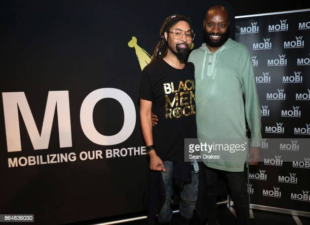 Creative director and celebrity fashion stylist Ty Hunter and film director and producer PatrikIan Polk pose during MOBI Talks a life mentoring...