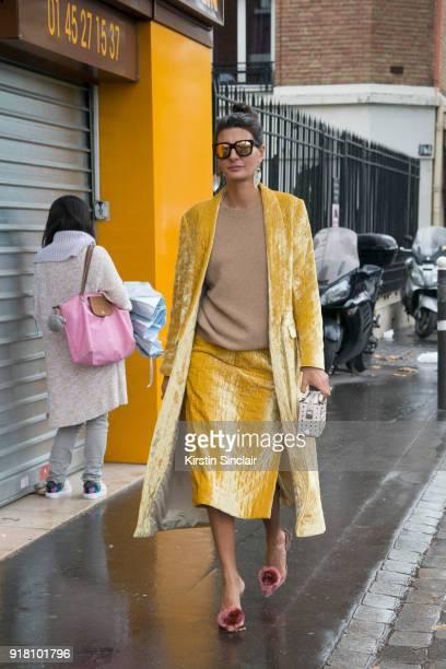 Creative director and fashion editor Giovanna Battaglia Engelbert wears a Dries van Noten coat and skirt Tod'u2019s bag Linda Farrow sunglasses and...