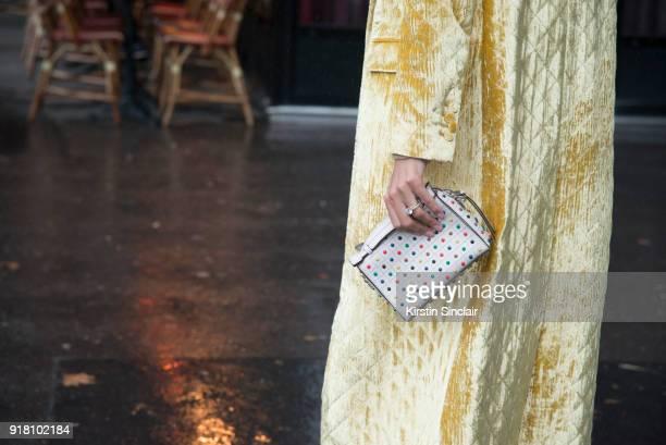 Creative director and fashion editor Giovanna Battaglia Engelbert wears a Dries van Noten coat and a Tod'u2019s bag day 6 of Paris Womens Fashion...