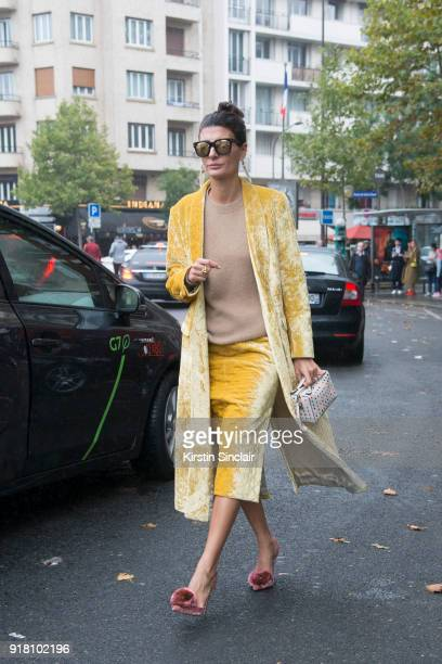 Creative director and fashion editor Giovanna Battaglia Engelbert wears a Dries van Noten coat and skirt Todu2019s bag and Altuzarra shoes day 6 of...