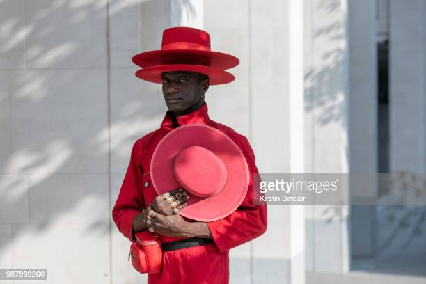 Creative Director and stylist Abdel Keita Tavares wears a Dickies boiler suit and his own design hats during London Fashion Week Men's on June 10...
