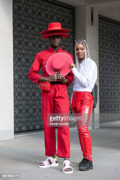 Creative Director and stylist Abdel Keita Tavares wears Doc Martens sandals Dickies boiler suit and his own design hats with Fashion designer Shanice...