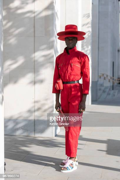 Creative Director and stylist Abdel Keita Tavares wears Doc Martens sandals Dickies boiler suit and his own design hats during London Fashion Week...