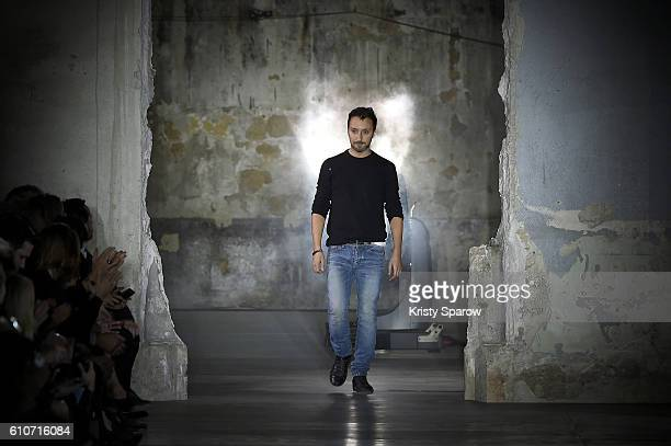 Creative Director Anthony Vaccarello acknowledges the audience during the Saint Laurent show as part of Paris Fashion Week Womenswear Spring/Summer...