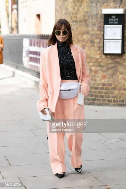 Creative Director at Restir Maiko Shibata wears a Roksanda Ilincic suit Proenza Schouler top Linda Farrow sunglasses Mason Margiela bum bag and...