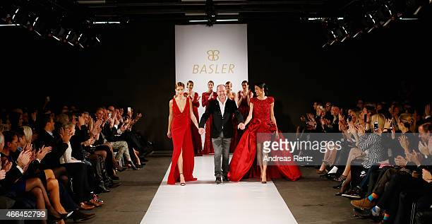 Creative Director Brian Rennie smiles with Julia Trainer and Rebecca Mir during the Basler fashion show on February 1 2014 in Dusseldorf Germany
