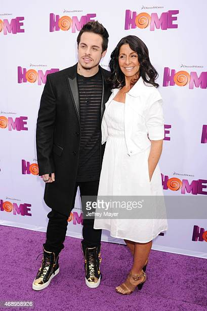 Creative Director Casper Smart and mother Shawna Lopaz arrive at the 'HOME' Los Angeles Premiere at Regency Village Theatre on March 22 2015 in...