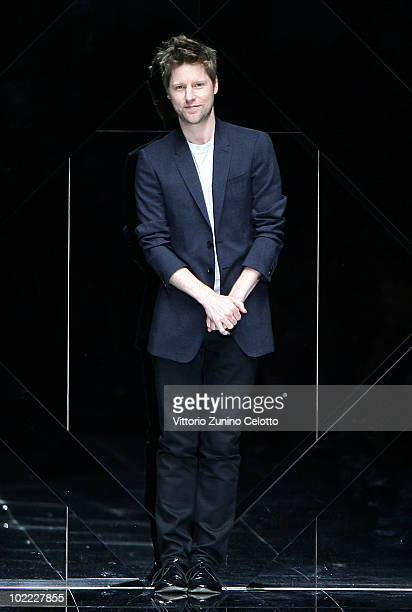 Creative director Christopher Bailey acknowledge the applause of the public after the Burberry Prorsum Milan Menswear Spring/Summer 2011 show on June...