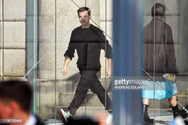 Creative director Daniel Lee arrives to acknowledge applause following the Bottega Veneta women's Fall/Winter 2019/2020 collection fashion show on...