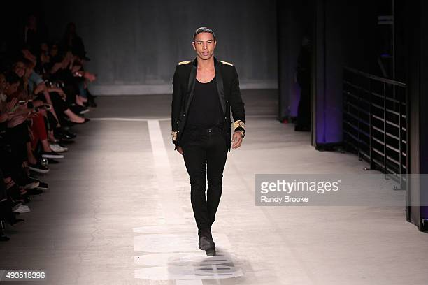 Creative Director for Balmain Olivier Rousteing walks the runway at the BALMAIN X HM Collection Launch at 23 Wall Street on October 20 2015 in New...