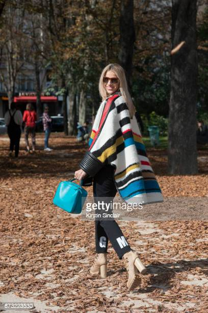 Creative Director Founder of Beyond The Mag Sophia Macks wears a Barbara Bui poncho and shoes Mark Cross bag MSGM trousers and Etro sunglasses day 4...