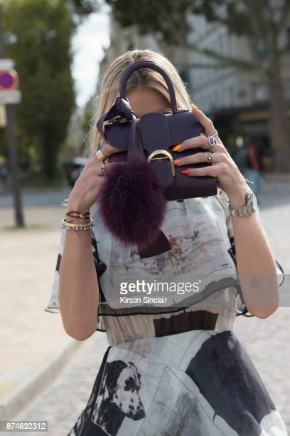 Creative Director Founder of Beyond The Mag Sophia Macks wears a MSGM dress and a Delvaux bag day 4 of Paris Womens Fashion Week Spring/Summer 2018...