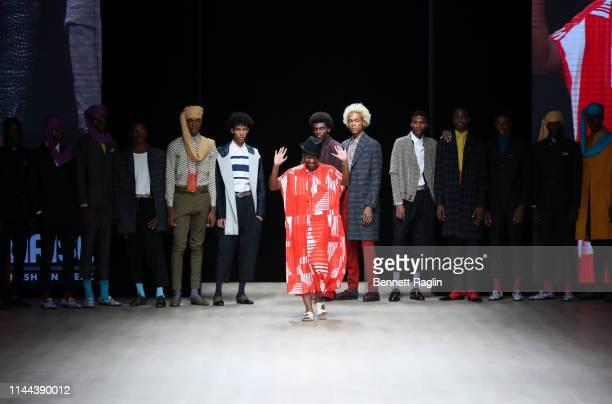 Creative director Gozi Ochonogor pose with model during Arise Fashion Week on April 21, 2019 in Lagos, Nigeria.