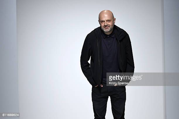 Creative Director Hussein Chalayan acknowledges the audience during the Chalayan show as part of Paris Fashion Week Womenswear Spring/Summer 2017 on...