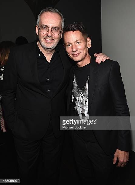 Creative Director Jim Moore and GQ EditorinChief Jim Nelson attend GQ and Giorgio Armani Grammys After Party at Hollywood Athletic Club on February 8...