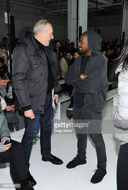 Creative Director Jim Moore and Kanye West attend the John Elliott CO fashion show at Skylight Clarkson SQ on February 13 2015 in New York City