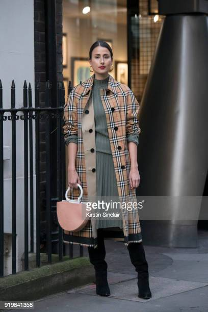 Creative director Julia Haghjoo wears a Burberry coat, Danse Lente bag, Maria Black earrings, Gianvito Rossi boots and an Uzwei dress on day one of...
